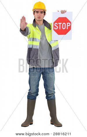 Traffic guard directing traffic