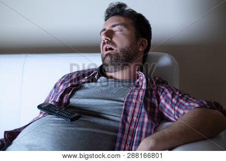 Portrait Of One Caucasian Man Watching Tv