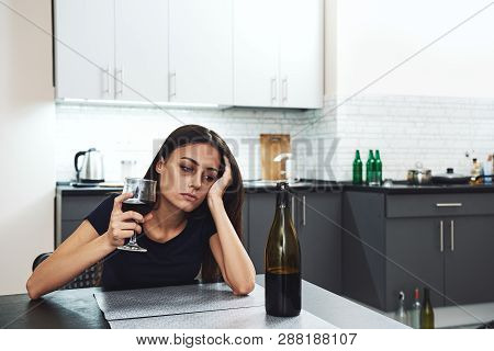 I Understood Myself Only After I Destroyed Myself. Young Addicted, Depressed Woman With Red Wine Sit