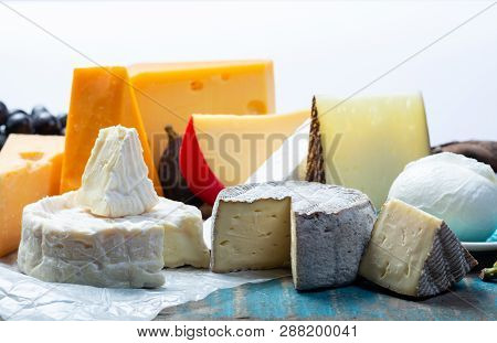 Famous European Cheeses In Assortment, Dutch Red Ball Edam And Old Cheeses With Holes, Spanish Manch