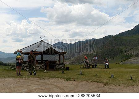 Altai Republic, Russia - June 8, 2018: Tourists In Kalbak-tash Tract, Gorny Altai, Siberia, Russia