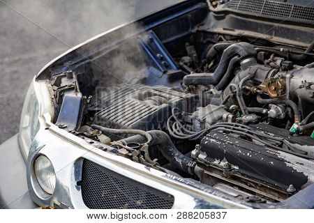 Car Engine Over Heat With No Water In Radiator And Cooling System. Overheated Car Machine Broken Dow