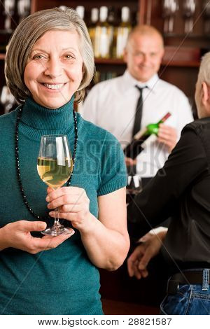Wine bar senior woman manager enjoy drink smiling barman discussing