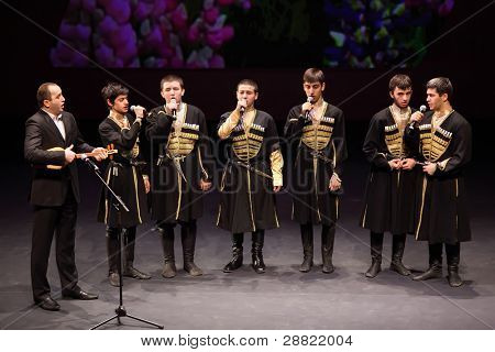 MOSCOW - MARCH 17: Boys sing at concert of Gennady Ledyakh School of Classical Dance in theater Et Cetera, on March 17, 2011 in Moscow, Russia. Concert held for winners in competition.