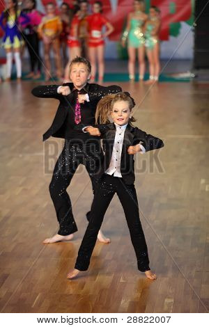 MOSCOW - MAY 4: Barefoot boy and girl dance at IX World Dance Olympiad, on May 4, 2011 in Moscow, Russia. 21 305 dancers from 31 countries and 165 cities participated in Olympiad.