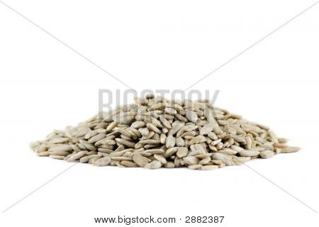 A Pile Of Sunflower Seeds Isolated On White Background