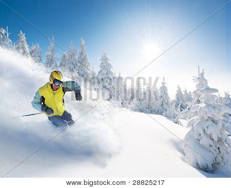 Skier in hight mountain