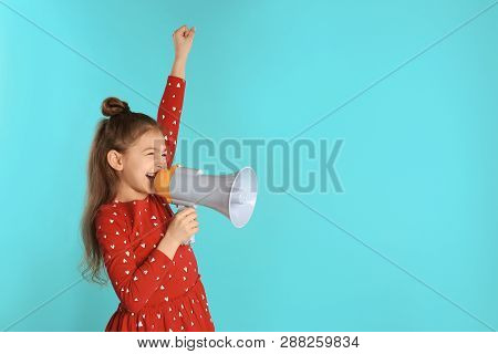 Cute Funny Girl With Megaphone On Color Background. Space For Text