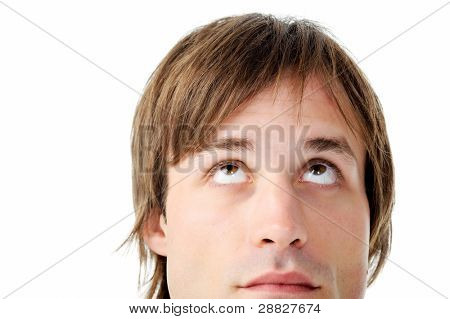 face of a man deep in thought, looking upward. vibrant portrait isolated on white