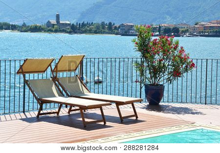 Sundeds against Como lake, Italy