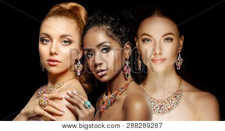 Beautiful Three models girls with set of Jewelry. Luxury girls in shine jewellry: Eearrings, Necklace, and Ring. Women in jewelry from Gold, Precious Stones, Siamonds. Beauty and accessories.
