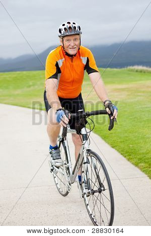happy active senior man riding bicycle