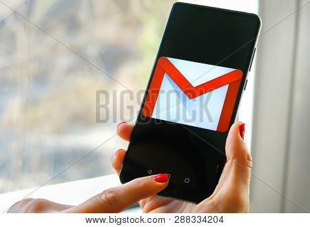Hand Check Emails With Gmail App By Google On Smartphone In Bologna, Italy, 08 March 2019