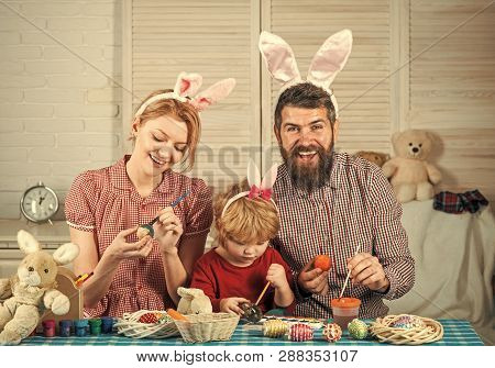Happy Easter Family Paint Eggs. Easter, Mother, Father And Child In Bunny Ears. Happy Family Celebra