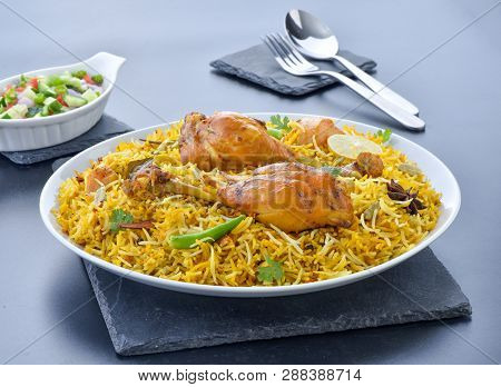 Chicken Biryani. A Deleciously Colorful Rice Dish Filled With Spicy Marinated Chicken Pieces With Sa