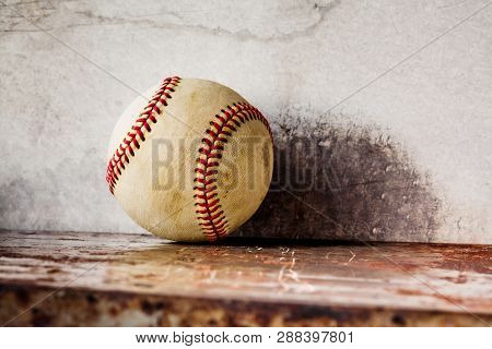 Old Baseball On Shabby Metal Textured Background. Macro View Ball, Shallow Depth Of Field, Copy Spac