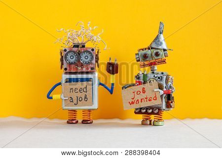 Job Search Concept. Two Robots Wants To Get A Job. Smiley Unemployed Robotic Characters With A Cardb