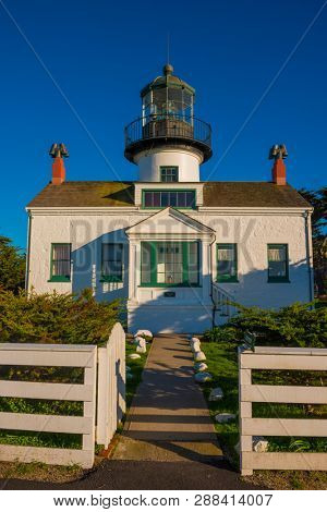 Lighthouse on Pacific Ocean in Monterey CA beautiful afternoon light fresnal lens historic