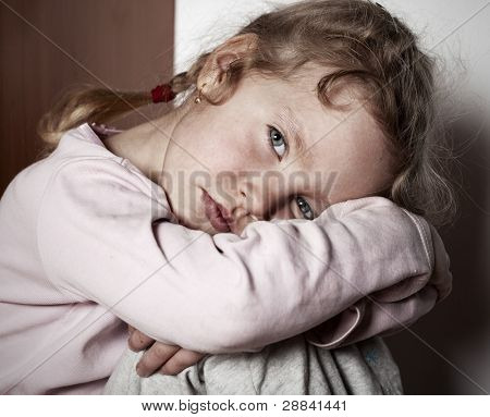 Sad little girl. Child's problems