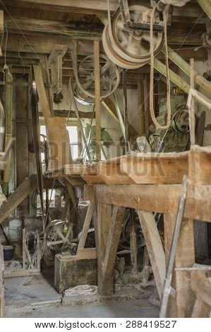 Traditional Artisan Wooden Flour Mill Equipment, Viewed From Side And Other Mill Pully Equipment, Be