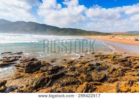 Waves In Porto Ferro Beach Shore. Sardinia, Italy