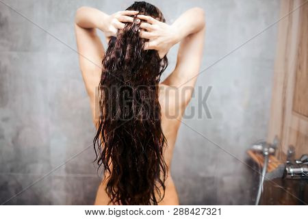 Young Attractive Sexy Woman In Shower. Dark-haired Caucasian Model With Well-built Slim Body Stand A