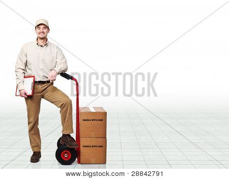 smiling young worker with hand truck
