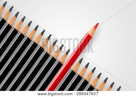 Business concept of disruption, leadership or think different; red pencil in row of black pencils standing out; minimal concept flat lay from above on white background poster