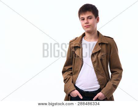 Portrait Of Caucasian Teen Boy On White Background.