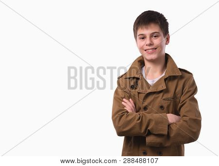 Portrait Of Happy Teen Boy With Folded Hands On White Background.