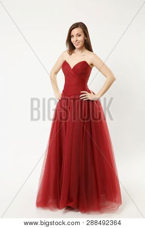 Full Length Photo Of Fashion Model Woman Wearing Elegant Evening Dress Gown Posing Isolated On White