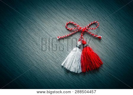 Bulgarian Traditional Spring Decor Martenitsa Tassel, Wooden Background. Baba Marta Holiday, Backdro