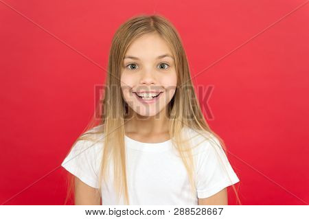 Brilliant Smile Concept. Girl Cute Smiling Face Over Red Background. Emotional Kid Happy Smiling Fac