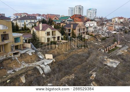 Landslide Caused By Rains Of Hurricane Destroyed Expensive Cottages And Houses. Destroyed House, Cot