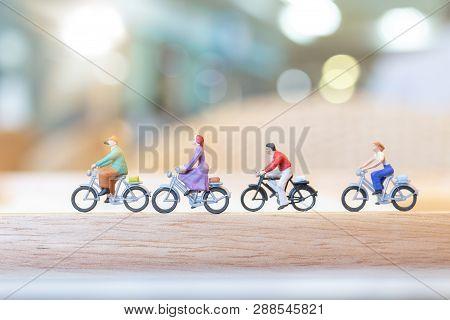Miniature People  Cycling On Wooden Bridge