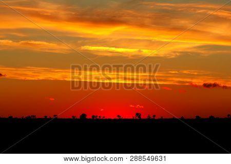 Fiery Orange Sunrise Sky.beautiful Sunrise, Light Majestic Clouds In The Sky