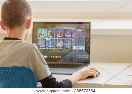 Vilnius, Lithuania - March 2, 2019: Boy Playing Fortnite Game. Fortnite Is Online Video Game Develop