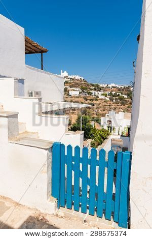 Sifnos, Greece - September 11, 2018: Blue Fence Of Typical House On Street Of Apollonia, The Capital