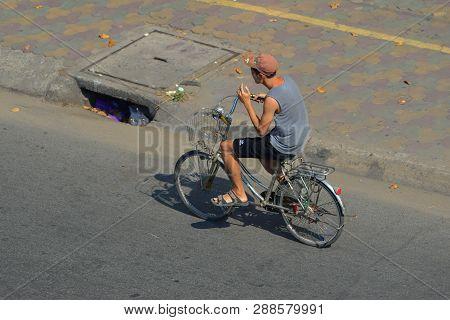 Saigon, Vietnam - Feb 1, 2019. A Man Biking On Street In Saigon, Vietnam. Saigon Is One Of The Citie