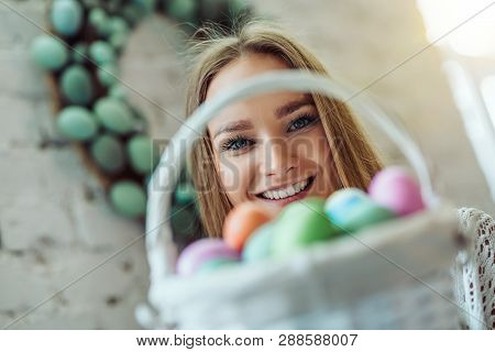 Happy Easter! Beautiful Young Woman With Basket Of Easter Eggs.