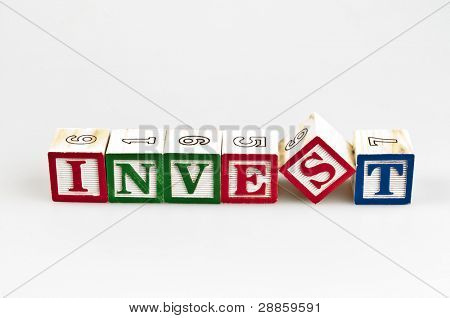 Invest word made by letter blocks