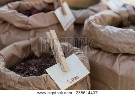 Cocoa Kernel Or Cocoa Nibs Stuffed Into Paper Sacks - Closeup Raw Food