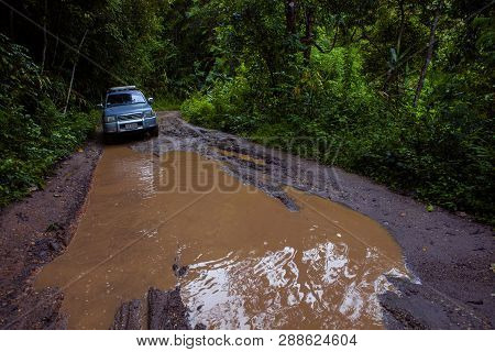 Chiangmai Thailand - September25,2013 : 4x4 Suv Car Approach For Passing Offroad Trail In High Mount