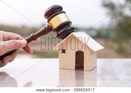 Judge Gavel And House Model Property Auction For Real Estate Law Concept. Lawyer Hand Holding Gavel