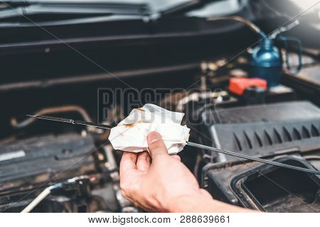Auto Mechanic Working In Garage Technician Hands Of Mechanic Oil Check Mechanic Working In Auto Repa