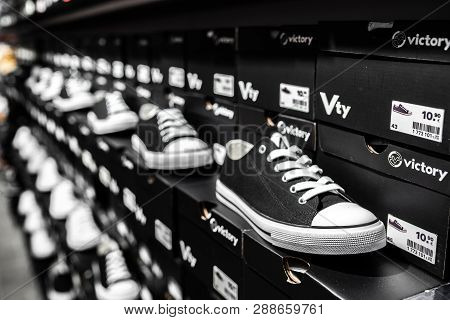 Nurmberg, Germany - February 27, 2019: The Adidas Black Man Sneakers On The Shell In The Shop. Fashi
