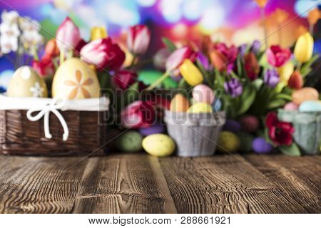 Easter Background. Easter Decorations. Rustic Wooden Table. Easter Basket With Eggs. Blue Bokeh Back