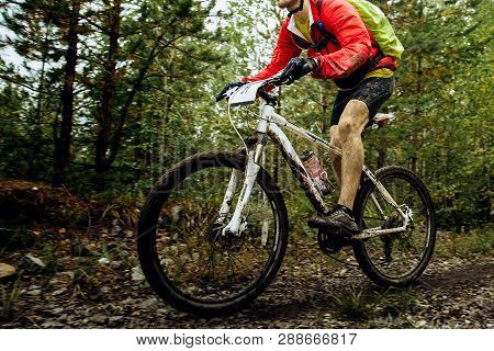 Athlete Cyclist On Mountainbike With Backpack Riding Forest Trail