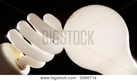 Cfl And Incandescent Lightbulbs On Black