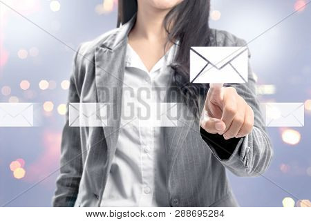 Business Woman Pointing Email Icons On Virtual Screen. Business Concept